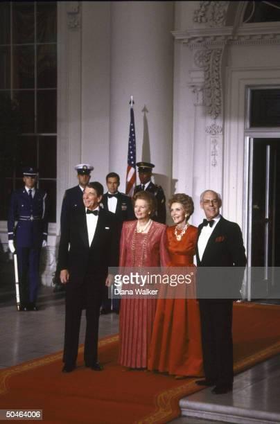 Pres Nancy Reagan w British PM Margaret Denis Thatcher poised on red carpet during State Dinner