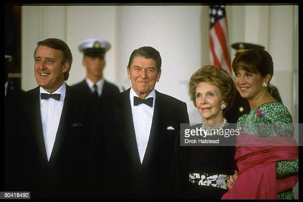 Pres Nancy Reagan w Canadian PM Brian Mila Mulroney men in black tie ladies in fancy gowns during WH state dinner