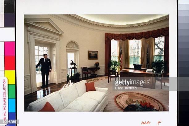 Pres Reagan pausing for last lingering look around Oval Office stripped of his personal touches ready for his successor on his final day at WH after...