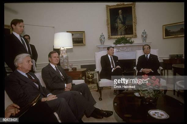 Pres Reagan VP Bush Dep State Secy John Whitehead seated in Swedish ivygraced Oval Office mtg w Japanese rep Sosuke Uno