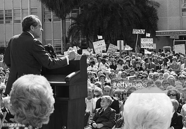 Pres Richard M Nixon addresses a gathering at dedication ceremonies of the Cedars of Lebanon Health Care Center In the background are protesters...