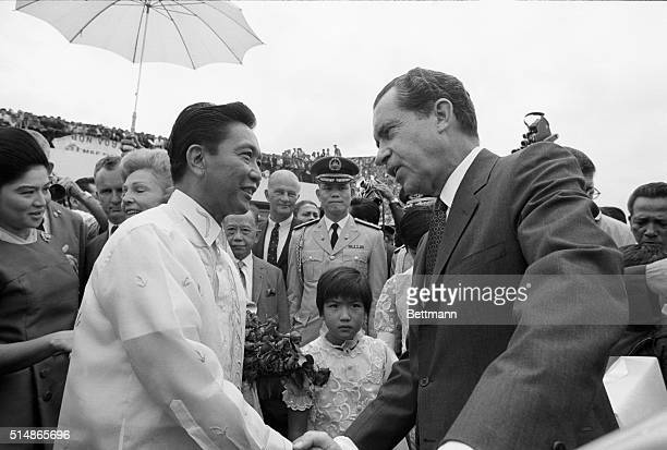 US Pres Richard Nixon shakes hands with Philippines Pres Ferdinand Marcos at airport here July 27th before taking off for Djakarta and the second leg...