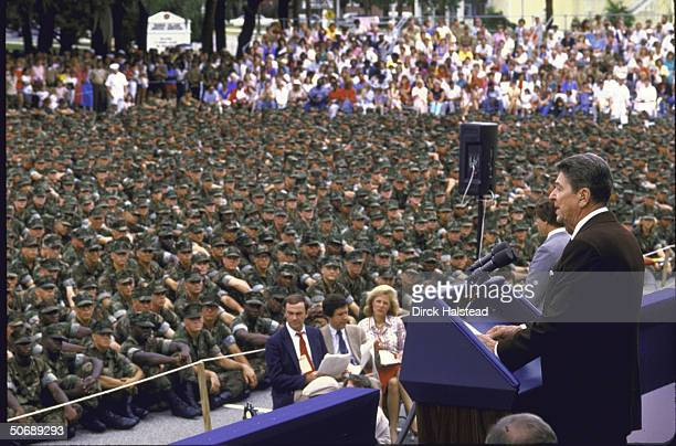 US Pres Ronald W Reagan addressing graduating class at Parris Island Marine Corps Training Center with reporters seated Sam Donaldson Chris Wallace...
