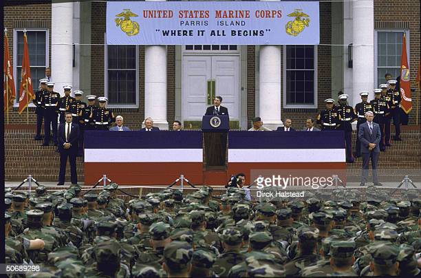 US Pres Ronald W Reagan addressing graduating class at Parris Island Marine Corps Training Center flanked by Senators Ernest F Hollings and J Strom...