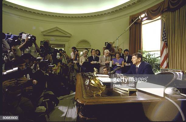 US Pres Ronald W Reagan during minipress conference regarding scab on nose after skin cancer excision with UPI's Helen Thomas and TIME Magazine's...