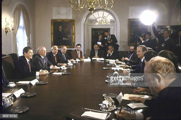 US Pres Ronald W Reagan meeting with business leaders in Cabinet Room including GM's Roger B Smith on right side of table OMB Dir James C Miller III...