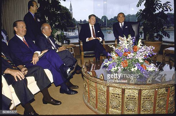 US Pres Ronald W Reagan meeting with Japanese Prime Minister Yasuhiro Nakasone as US Treasury Secy James A Baker III and Secy of State George P...