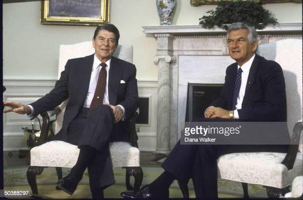 US Pres Ronald W Reagan seated talking with Australian PM Robert J L Hawke in Oval Office