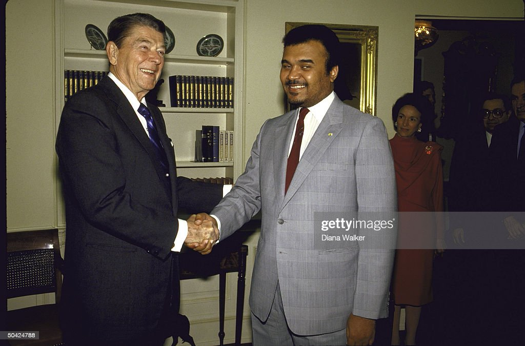Pres. Ronald W. Reagan shaking hands with Saudi Amb. Prince Bandar (R) during WH arrival of Arab League delegation, with Protocol Chief Selwa Roosevelt (far R).