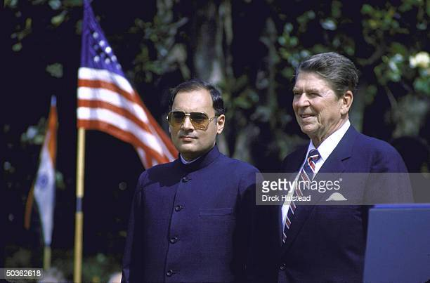 US Pres Ronald W Reagan standing with Indian PM Rajiv Gandhi during WH ceremony