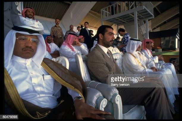 Pres Saddam 's son Udai in VIP stand during soccer match pitting Iraq Qatar