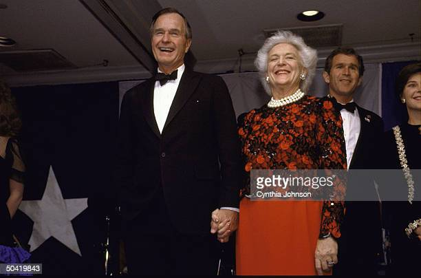 Pres signature pearls sporting Barbara Bush having high old time at TXstyle black tie boots inaugural ball w son George Laura Bush