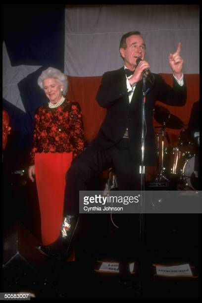 Pres signature pearls sporting Barbara Bush having high old time at TXstyle black tie boots inaugural ball as Pres shows off his TX boots