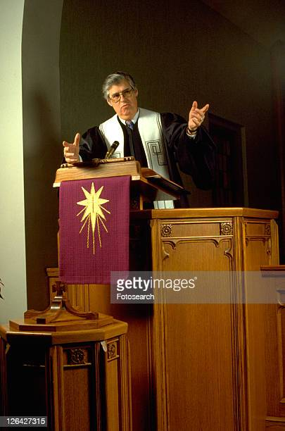 Presbyterian minister preaching from his pulpit