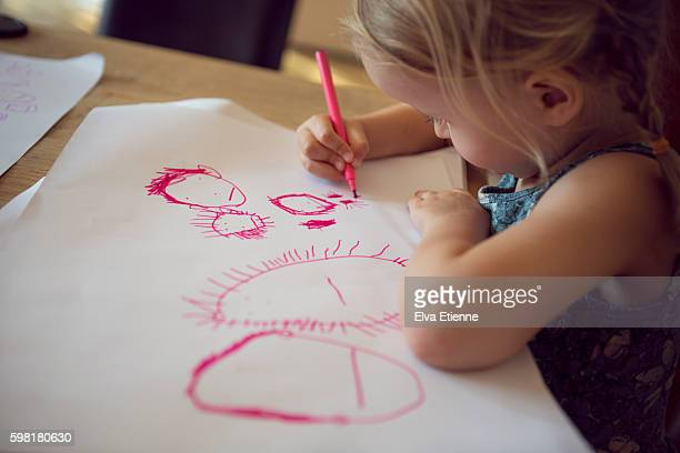 Preschool age child drawing a picture
