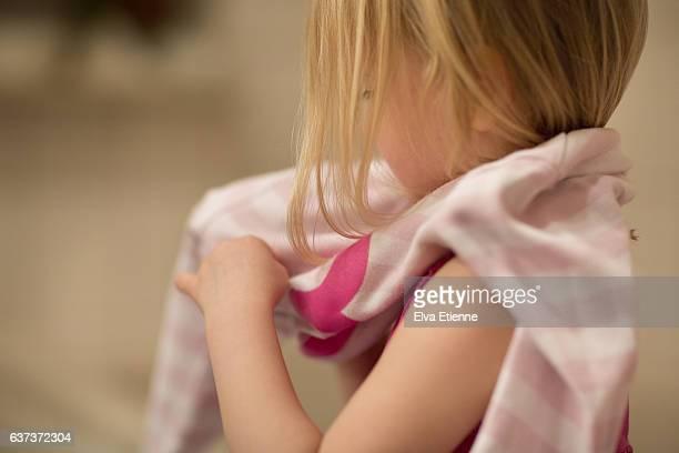 Preschool age child getting dressed