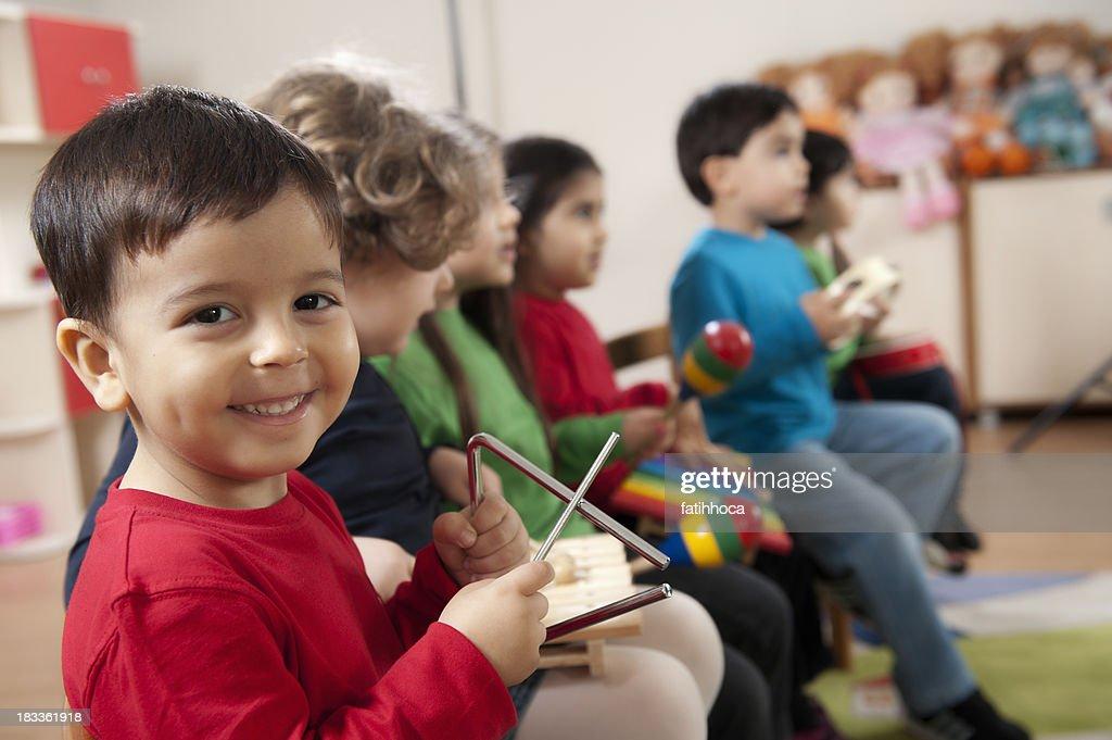 Preschool age children in music class : Stock Photo