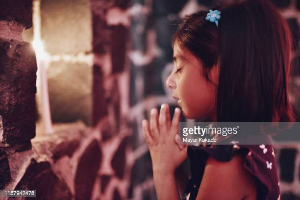 preschool age girl praying - hinduism stock pictures, royalty-free photos & images