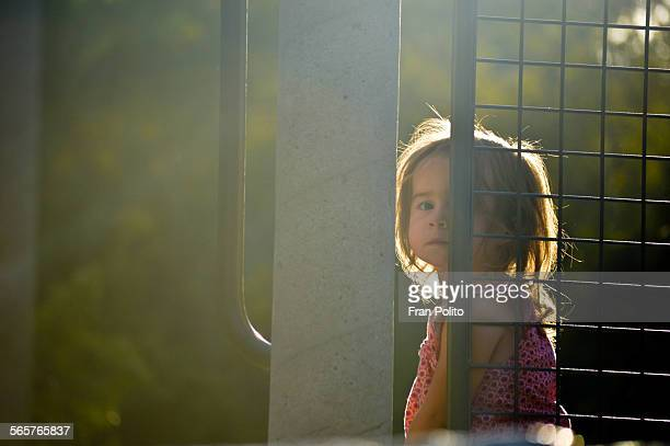 a preschool aged girl looking sad at the park. - poverty in america stock pictures, royalty-free photos & images