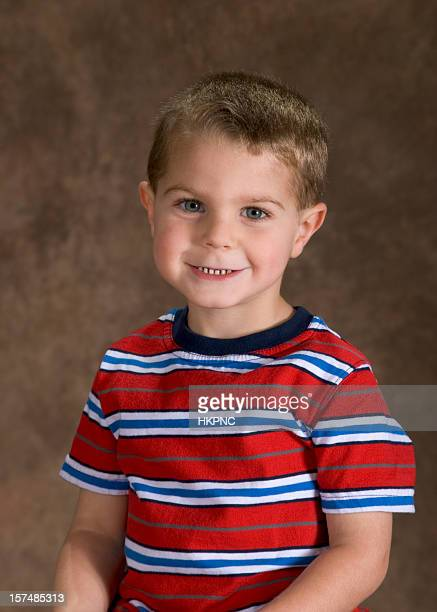 Preschool Boy Sitting For His School Picture, Cute Pose