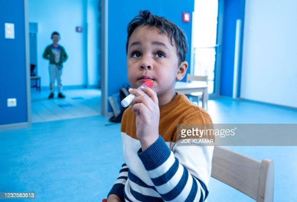 Pre-school boy uses a newly developed, lollipop-shaped Covid-19 test prior to the testing of pre-schoolers at the 'City of Vienna Kindergarten' in...