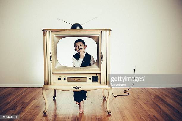 preschool child playing anchorman in old tv - television show stock pictures, royalty-free photos & images
