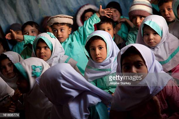 Pre-school children at a community-run childcare class in Injil district, outside Herat, Nov 29, 2011. There are more than 800 children enrolled in...