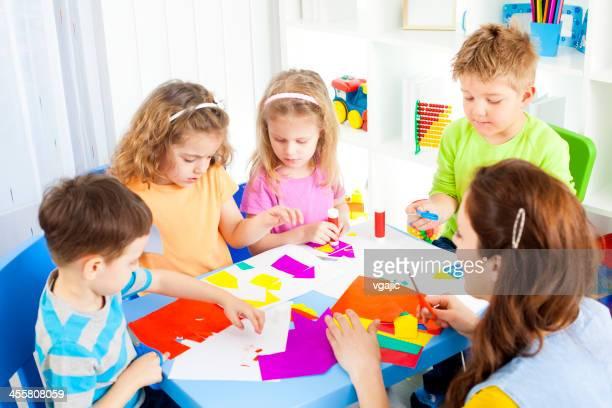Preschool: Children Craft Activities with color paper and glue.