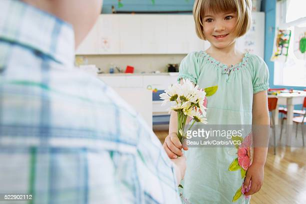 Preschool children exchanging flowers
