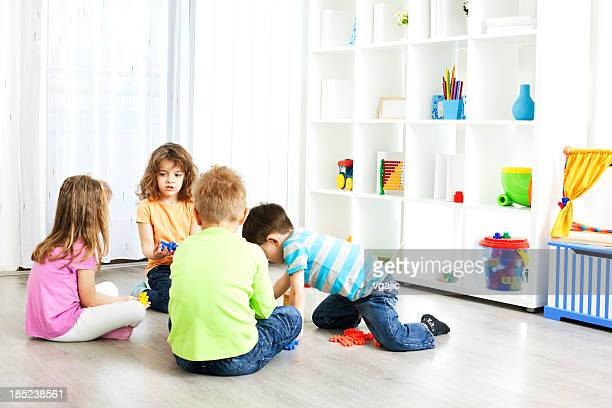 Preschool: Children Having Activities with Blocks Puzzle.
