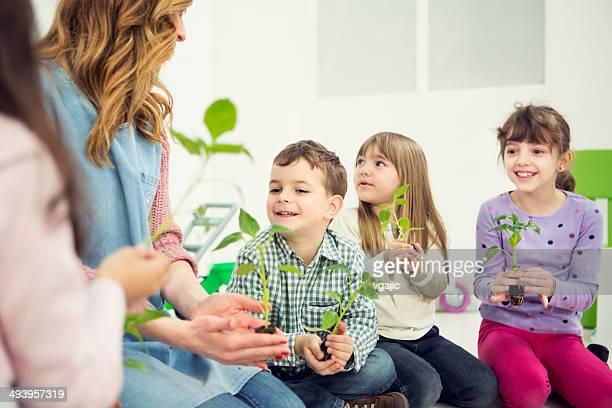 Preschool Children Holding Baby Plants in hands.