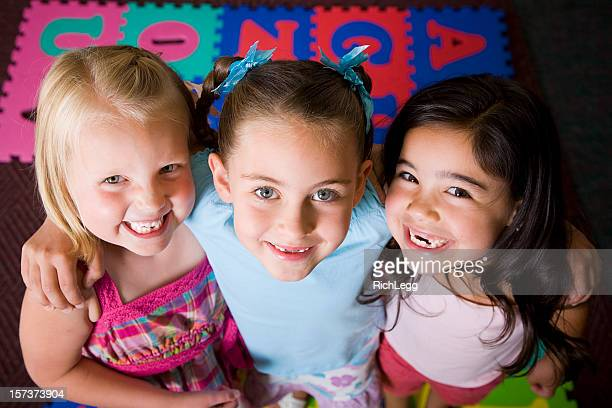 preschool children in a classroom - rich_legg stock pictures, royalty-free photos & images