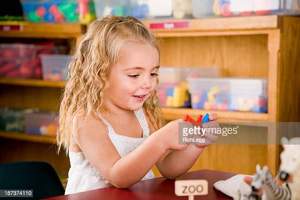 preschool children in a classroom - rich_legg stock photos and pictures
