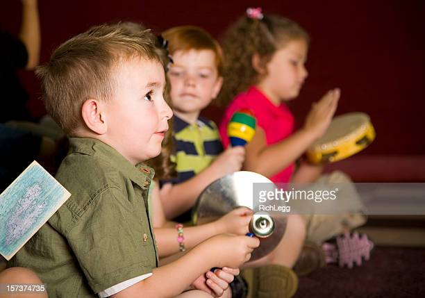 preschool children in a music class - rich_legg stock pictures, royalty-free photos & images