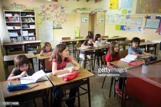 pre-school children in class learning from the teacher - state school stock pictures, royalty-free photos & images