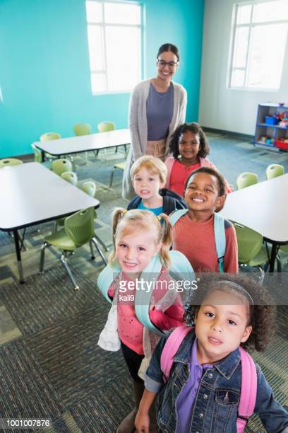 preschool children lined up in classroom with teacher - vertical stock pictures, royalty-free photos & images