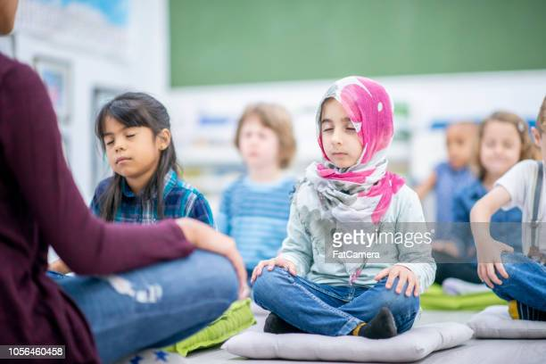 Preschool children meditating cross-legged