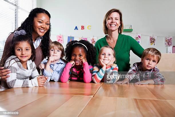 Preschool children with teachers in classroom