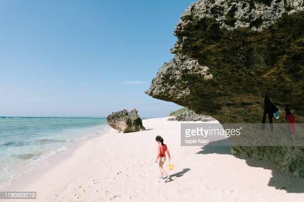 Preschool girl playing on idyllic tropical beach, Okinawa, Japan