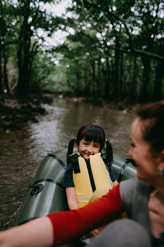 Preschool girl smiling and having fun with raft in mangrove swamp, Japan - gettyimageskorea