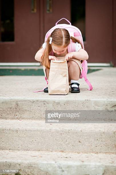 Preschool Girl Student Looking in Lunch Bag