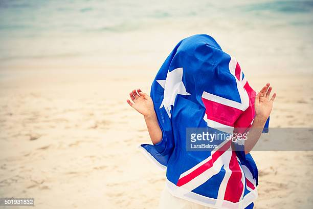 preschool girl with australian flag on the beach - australia day stock pictures, royalty-free photos & images