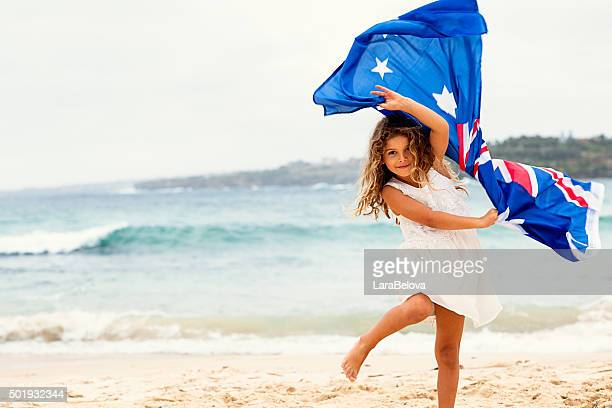 preschool girl with australian flag on the beach - australian flag stock pictures, royalty-free photos & images