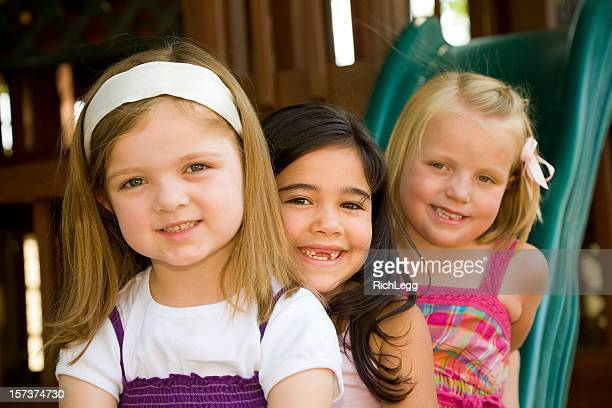 preschool girls on a playground - rich_legg stock pictures, royalty-free photos & images