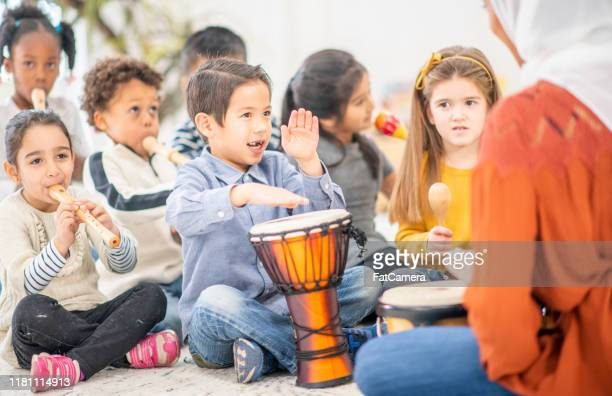 preschool music class stock photo - musical instrument stock pictures, royalty-free photos & images