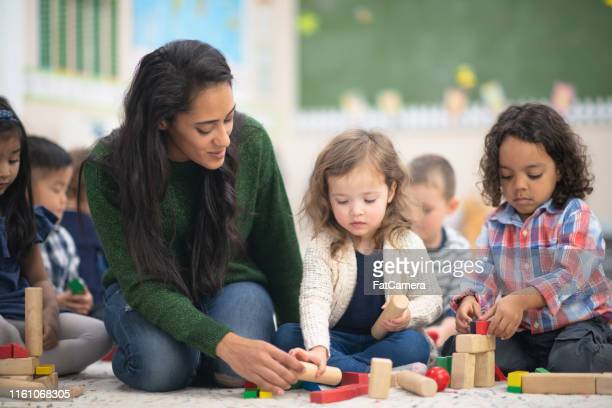 preschool play time - montessori education stock pictures, royalty-free photos & images