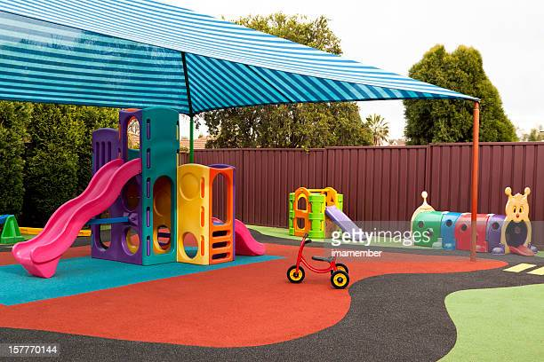 Preschool playground with sunshade and playgraound equipment