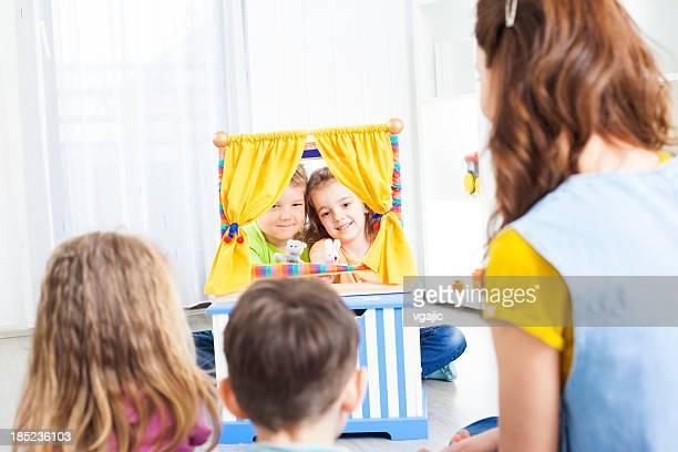 preschool: preschoolers craft activities puppet show. - puppet show stock photos and pictures