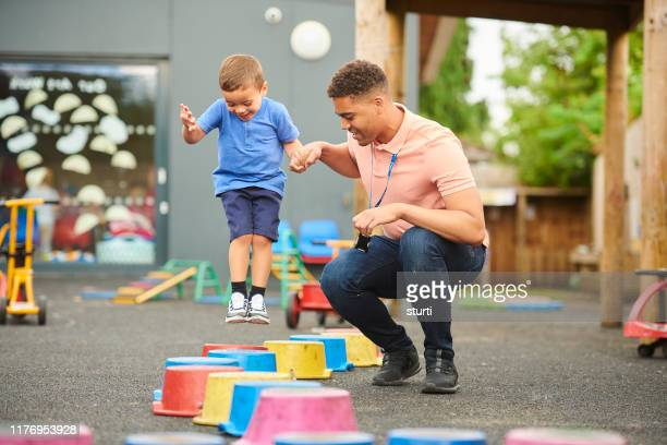 pre-school stepping stones - jumping stock pictures, royalty-free photos & images