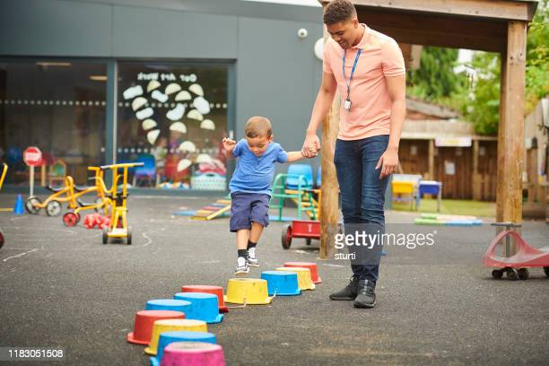pre-school stepping stones - instructor stock pictures, royalty-free photos & images